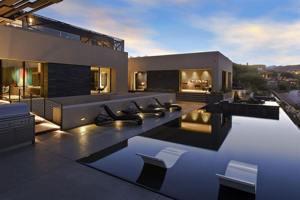 modernes einfamilienhaus terrasse gestaltung hängesessel kamin ventilation passiv