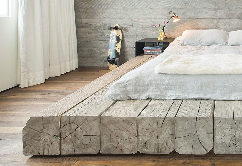 A Platform Bed Made Using Reclaimed Logs 2